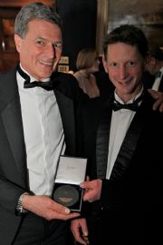 Alasdair Flint and Tim Loftus receiving their prestigious Tilman medal from the Royal Cruising Club